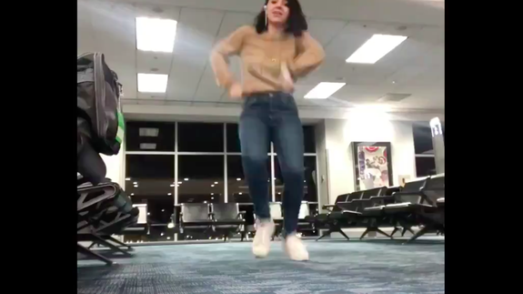Woman stuck in airport fights terminal boredom by making a hilarious dance video