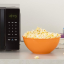 Grab the AmazonBasics voice-controlled microwave and an Echo Dot and save $25